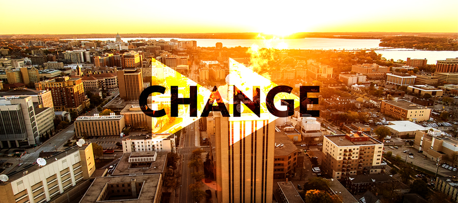 "The word ""Change"" write over two right facing arrows on a sunrise photo of the UW–Madison campus."
