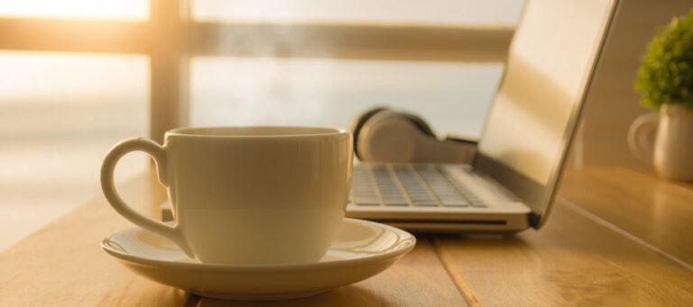 Cup of tea next to laptop