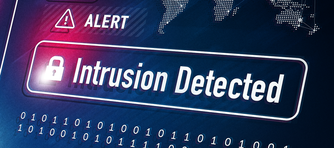 """""""Alert, intrusion detected"""" text on warning screen."""