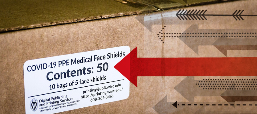 Box containing face shields