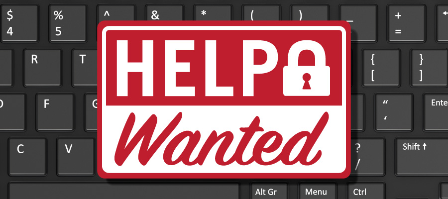 Help Wanted Sign on Computer Keyboard