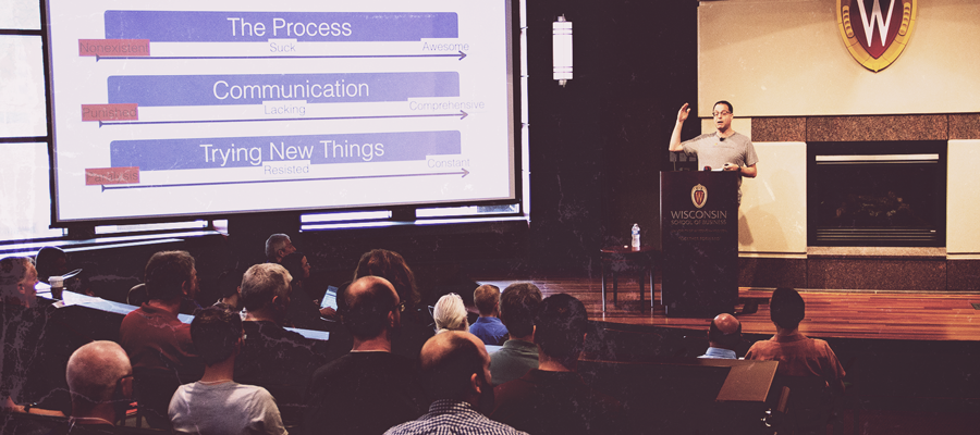 A speaker presents to a crowd at the IT Professionals Conference 2019