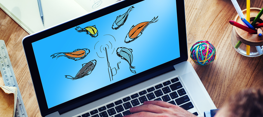 Laptop with multiple fish around a fishing pole on screen.
