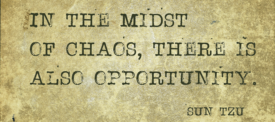 "Parchment paper that reads, ""In the midst of change, there is also opportunity. –Sun Tzu"""