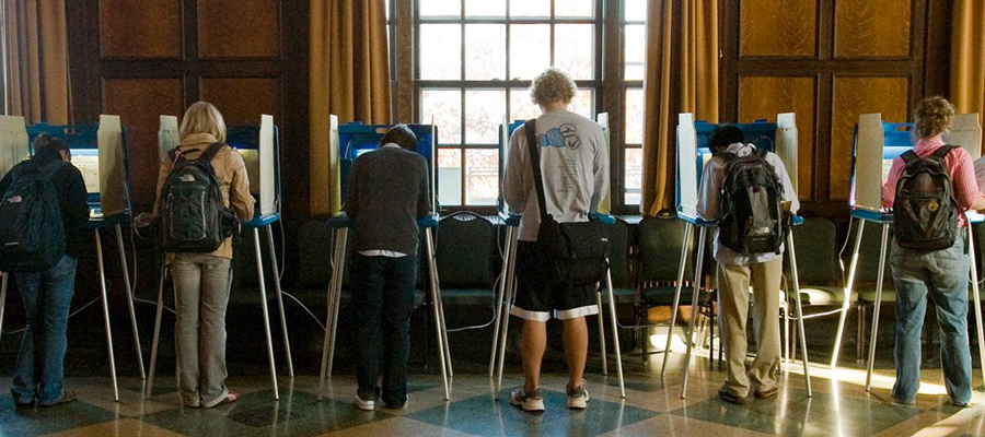 Students voting in voting booths