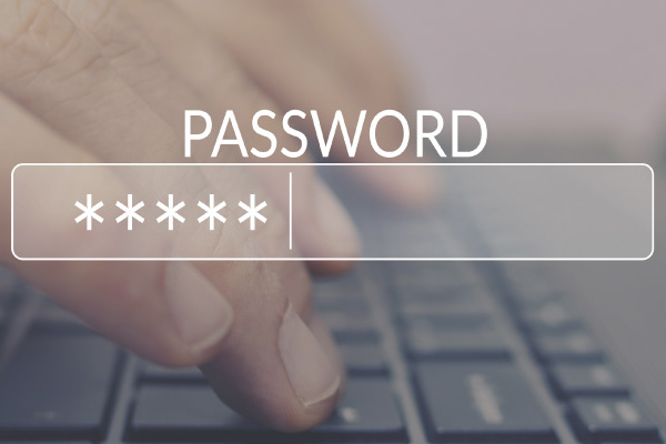 password field superimposed over hands typing on a keyboard