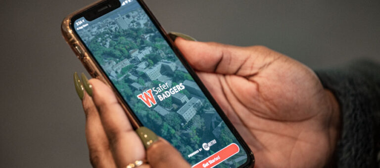 Person using Safer Badgers app on a smartphone