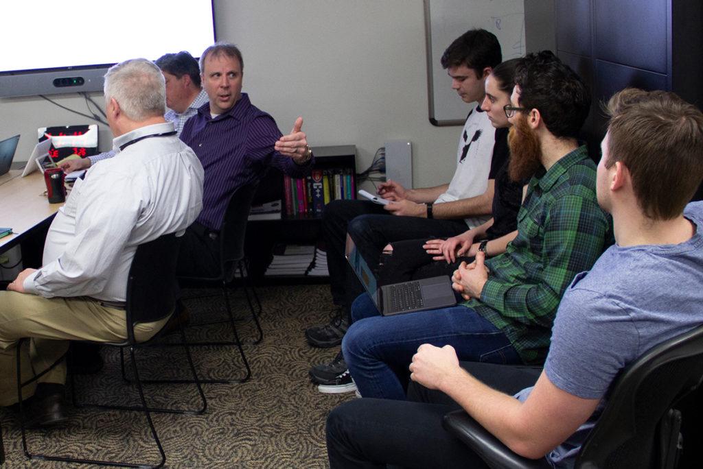 Jeffrey Savoy mentoring group of employees