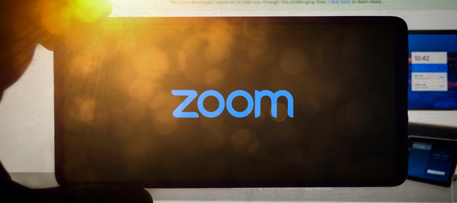 "Blue background with a video camera icon in a circle and the word ""zoom"""